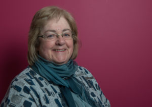 Brenda Garrard. SDSS Management Committee on pink background
