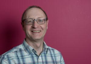 Mark Han-Johnston on pink background