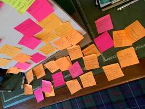 Post it notes stuck to a board with answers to the question 'what do you want to achieve from the AGM' accesible version can be found below